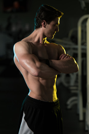 showing muscles: Bodybuilder Posing In Different Poses Demonstrating Their Muscles - Male Showing Muscles Straining - Beautiful Muscular Body Athlete