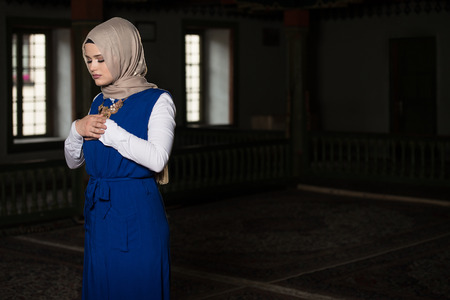 namaz: Humble Muslim Woman Is Praying In The Mosque Stock Photo