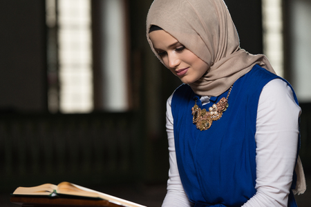 Humble Muslim Woman Is Reading The Koran In The Mosque Stock Photo
