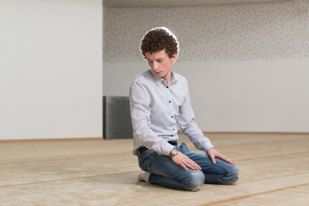 afro arab: Humble White Muslim Man Is Praying In The Mosque - Afro Lock Hair Curly