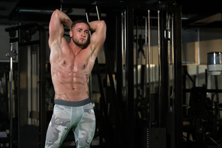straining: Bodybuilder Posing In Different Poses Demonstrating Their Muscles - Male Showing Muscles Straining - Beautiful Muscular Body Athlete