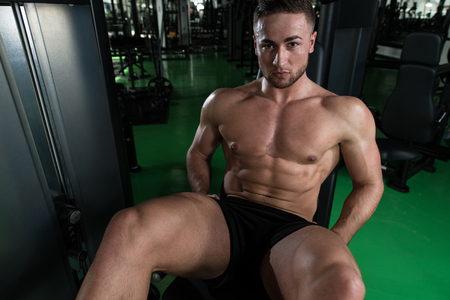 quadriceps: Leg Exercises Close Up -  Man Doing Leg With Machine In Gym