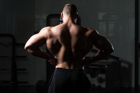 bodyart: Bodybuilder Posing - Handsome Power Athletic Guy Male - Fitness Muscular Body Stock Photo