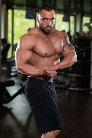 sixpack: Bodybuilder Posing - Handsome Power Athletic Guy Male - Fitness Muscular Body Stock Photo