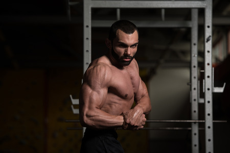 pectoral muscle: Portrait Of A Young Physically Fit Man Performing Side Chest Pose - Muscular Athletic Bodybuilder Fitness Model Posing After Exercises Stock Photo