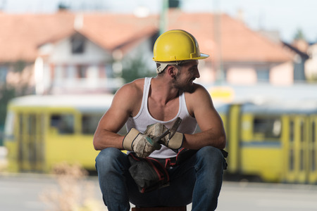 Construction Worker Relaxing The Fresh Air During Work Stock Photo