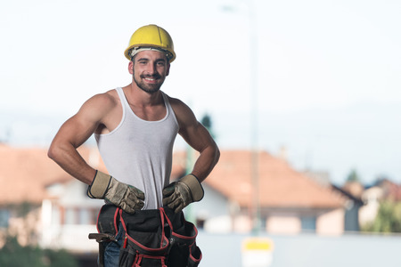 Portrait Of Handsome Male Architect Engineer With Yellow Helmet Stock Photo
