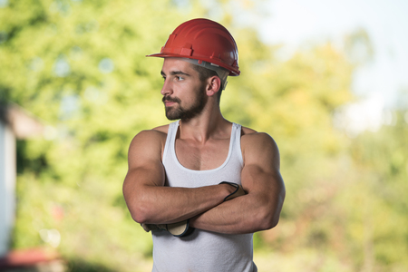 casco rojo: Portrait Of Handsome Male Architect Engineer With Red Helmet