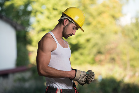 Successful Male Architect At A Building Site With Gloves Takes Off