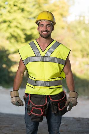 yellow helmet: Portrait Of Handsome Male Architect Engineer With Yellow Helmet Stock Photo