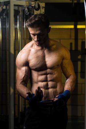 wrist strap: Muscled Boxer Wearing Blue Strap On Wrist Stock Photo