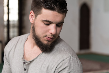 humble: Humble Muslim Man Is Praying In The Mosque