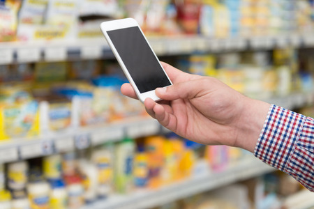 Man Using Mobile Phone Close-up While Shopping In Shopping Store