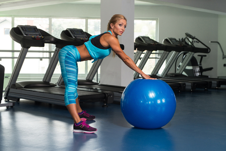 respite: Mature Fitness Woman Working Out In Gym Fitness Center On Ball