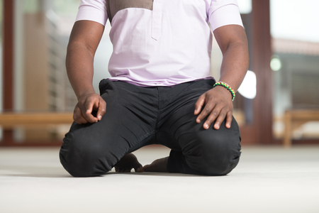 Black African Muslim Man Is Praying In The Mosque Stock Photo