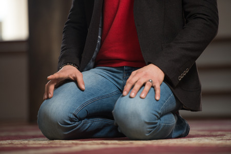 Close Up Of Man Hands Praying In Mosque