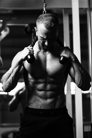 physique: Man Athlete Doing Abs Exercise On Machine With As Part Of Bodybuilding Training