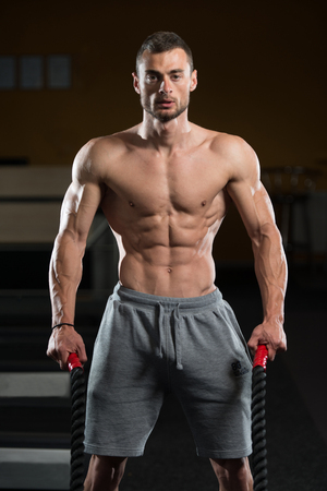Battling Ropes Young Man At Gym Workout Exercise Stock Photo