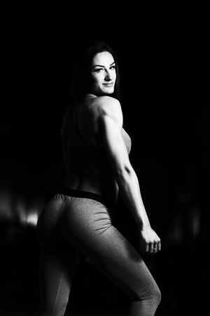 physically fit: Portrait Of A Young Physically Fit Woman Showing Her Well Trained Body - Beautiful Athletic Fitness Model Posing After Exercises