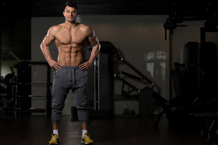 Portrait Of A Young Physically Fit Man Showing His Well Trained Body - Muscular Athletic Bodybuilder Fitness Model Posing After Exercises Stok Fotoğraf