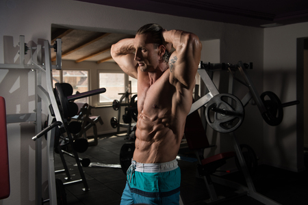 physique: Healthy Mature Tattoo Man Standing Strong In The Gym And Flexing Muscles - Muscular Athletic Bodybuilder Fitness Model Posing After Exercises