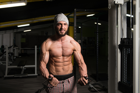 crossover: Man In The Gym Exercising On His Chest With Cable Crossover In Gym