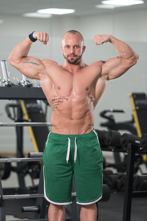 physically fit: Portrait Of A Young Physically Fit Tattoo Man Showing His Well Trained Body - Muscular Athletic Bodybuilder Fitness Model Posing After Exercises