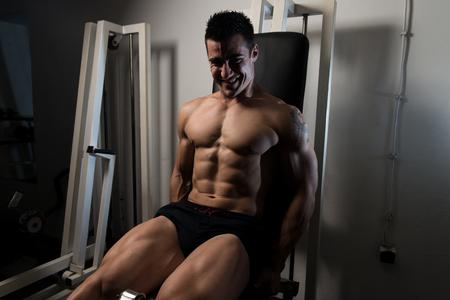 Leg Exercises - Man Doing Leg With Machine In Gym
