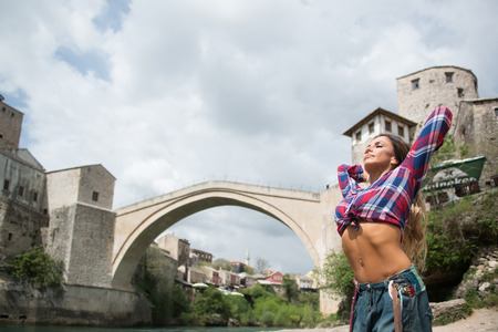 Portrait Of A Physically Fit Woman Showing Her Well Trained Body Outdoors Under The Bridge Stock Photo