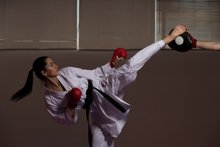 jujitsu: Young Woman Practicing Her Karate Moves - White Kimono - Black Belt