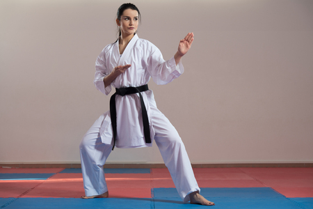 jujitsu: Young Woman Dressed In Traditional Kimono Practicing Her Karate Moves - Black Belt