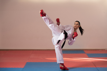 Young Woman Practicing Her Karate Moves - White Kimono - Black Belt
