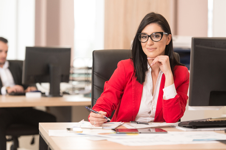 Business Ladie Writing A Letter - Notes Or Correspondence Or Signing A Document Or Agreement