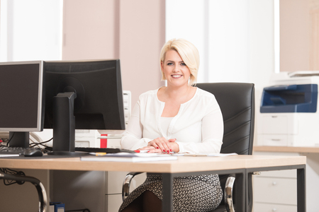 Happy Young Business Woman Work In Modern Office On Computer Stock Photo