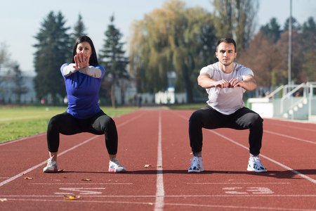 Young Couple Exercising in City Park Area - Training and Exercising for Endurance - Fitness Healthy Lifestyle Concept Outdoor