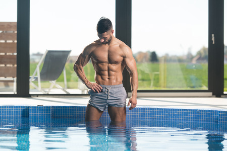 Fashion Portrait Of A Very Muscular Sexy Man In Underwear At Swimming Pool Фото со стока