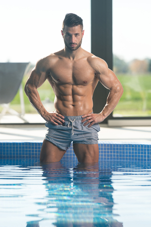 Fashion Portrait Of A Very Muscular Sexy Man In Underwear At Swimming Pool Stockfoto