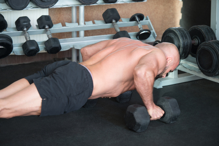 Athlete Doing Pushups With Dumbbells As Part Of Bodybuilding Training