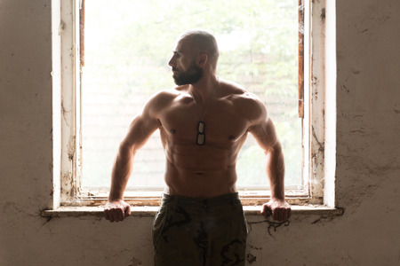 Portrait of a Physically Fit Man Showing His Well Trained Body - Muscular Athletic Bodybuilder Fitness Man Posing After Exercises Inside Ruins