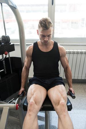 Leg Exercises Close Up -  Man Doing Leg With Machine In Gym Stock fotó - 97710982