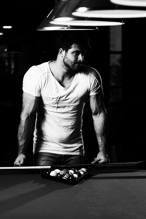 Portrait Of A Young Man Playing Billiards Pool Game