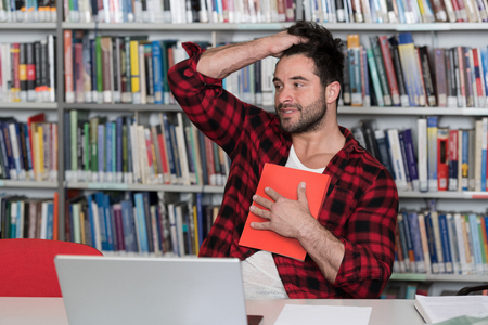 Young Man Student Feel Bored While Trying to Studying Entry Exams to University or College