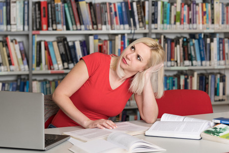 Young Woman Student Feel Bored While Trying to Studying Entry Exams to University or College Stock Photo