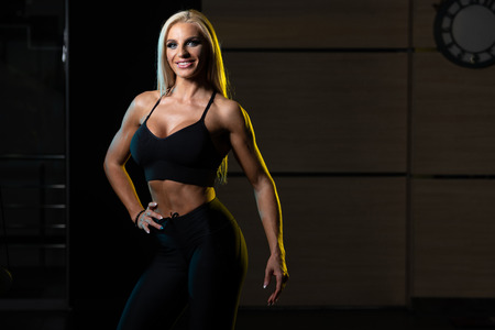 Portrait Of A Young Physically Fit Woman Showing Her Well Trained Body - Beautiful Athletic Fitness Model Posing After Exercises