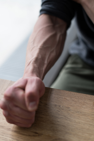 Man Showing Vascularity On Arm Close-up