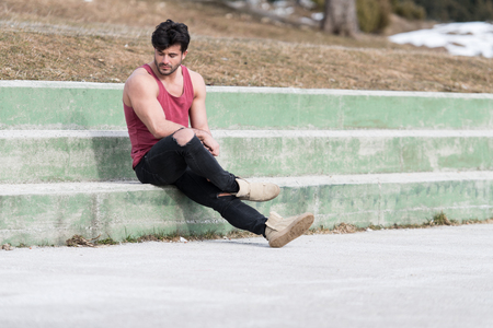 Portrait of a Young Physically Fit Man Showing His Well Trained Body While Wearing Black Jeans - Muscular Athletic Bodybuilder Fitness Model Posing Outdoors - a Place for Your Text Stock fotó