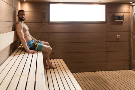 Happy Good Looking And Attractive Young Man With Muscular Body Relaxing In Hot Sauna Stok Fotoğraf