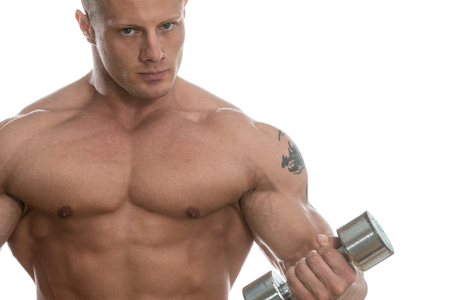 Young Muscular Bodybuilder Guy Doing Exercises With Dumbbells Over White Background Banque d'images