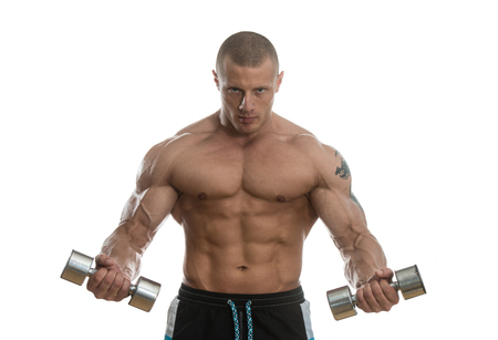 Young Muscular Bodybuilder Guy Doing Exercises With Dumbbells Over White Background Stock Photo