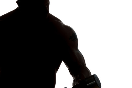Silhouette Young Muscular Bodybuilder Guy Doing Exercises With Dumbbells Over White Background Stock Photo